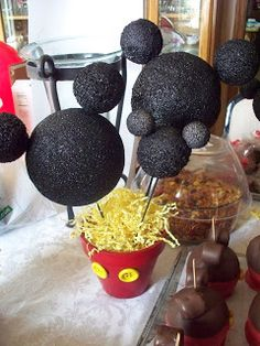 Tiagos birthday: These are our centerpieces we made from styrofoam painted black. We just painted the cheap clay pots found in any garden center at Walmart. The buttons were just glued on.