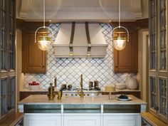 Pendant lights, range hood, backsplash
