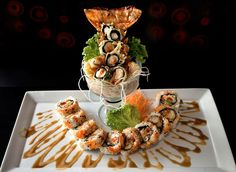 """The Rock-N-Roll Showcase Roll at the Lemon Grass is made with  whole lobster tail tempura, asparagus, scallions, avocado, roe and sesame and served with the chef's """"swirl sauce."""""""