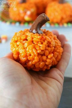 Rice krispy treat with orange food coloring shaped into round pumpkins with a tootsie roll stem!