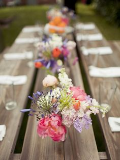 love these flowers against the wooden table! I really am not a fan of table linens :)  (coral peonies and lilac flowers)