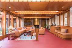 In the family room—which also holds a gold leaf-covered concrete fireplace—large skylights run the width of the space.
