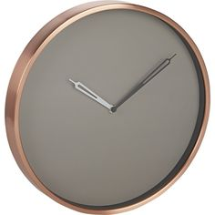 Shop copper wall clock.   Rimmed in a shiny circle of rose gold, this gleaming aluminum wall clock is perfectly timed with the trend.  Sophisticated quartz movement tells time on a clean grey face while two-color hands tick away the minutes.