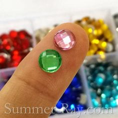 6 mm globe cut rhinestones in a collection of 10 mixed colors in one storage box.