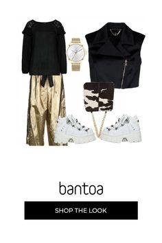 Pantaloni dorati con maglia e file nero. borsa e orologio sposano il tutto. le scarpe sportive cosi alte servono a dare più slancio vistala larghezza del pantalone.