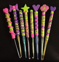 Crochet hooks with handles I made with polymer clay. The first one, the one with the yarn ball, is my favorite.