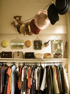 Hat storage idea-clothes pins, S hooks or curtain hangers! I also love how they decorated the top shelf area of the closet with their purses