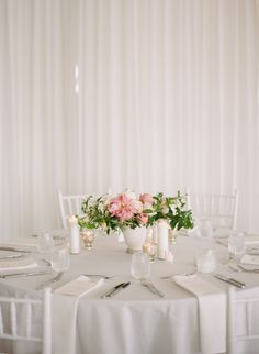 light and airy reception | light grey table cloth, white napkins, white chiavari chairs | Style Me Pretty The Vault