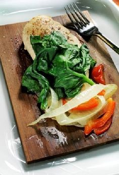 Photo - Cedar-planked Chicken with Caramelized Vegetables. Plank cooking can add flavor without fat to almost any type of meat.  Photo by MCCLATCHY