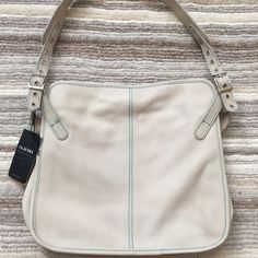 Claudia Leather Tote Bag NWT Italian brand Claudia ivory leather with teal stitching, snap closure and teal fabric lined interior.  Scuff mark at bottom of one side and brownish mark by snap closure as pictured. Claudia Bags Totes
