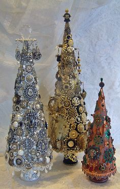 Jeweled Trees Tutorial - The trees are covered with a combination of buttons, beads, filigree, paper clay embellishments, jewels, metallic Dresden, metallic stickers and other metal bits and bobs.  Two of the trees have ways of hanging earrings and necklaces.
