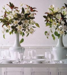All white table with big stunning floral centerpieces. #camillestyles #marthastewartweddings