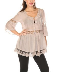 Sprightly and stylish, this top offers a fresh way to reinvent an outfit. Lovely lace exudes feminine appeal, while a cotton-silk blend provides a touch of luxe.