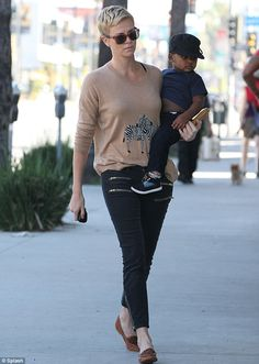 Great jeans! She and her little one looked good in dark denim trousers