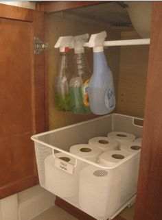 Use a tension rod to get bottles off the cabinet floor, making room for other things. I love the pull out box but the tension rod doesn't hold more than the 3 bottles shown. Organisation Hacks, Organizing Hacks, Organizing Your Home, Bathroom Organization, Bathroom Storage, Storage Organization, Cleaning Hacks, Bathroom Hacks, Bathroom Cabinets