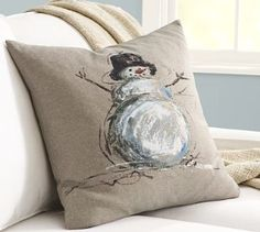 Hand-Painted Snowman Linen Pillow Cover | A classic icon of wintertime cheer, a jolly snowman brings character to this linen-cotton pillow.