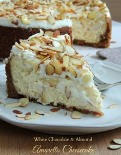 This Creamy White Chocolate & Almond Amaretto Cheesecake is a delicious dessert that's perfect for a special occasion or just because!