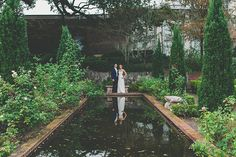 A beautiful bride and her groom share a moment in our Italian Gardens | Nicole Piper Phography