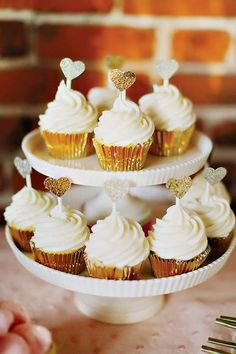 Adorable cupcakes with gold foil liners and little heart toppers #wedding #weddingcupcakes #gold #cupcakes #diywedding