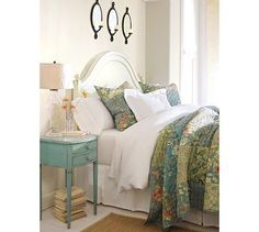 Cottage Bedroom: curvy white wood bed, layers of white bedding with quilt of soft blues & greens, antique-blue bedside table, and a glass lamp . so inviting. I am so liking this, our bed painted blue table. Home Bedroom, Bedroom Decor, Bedroom Ideas, Bedroom Modern, Design Bedroom, Master Bedrooms, Bedroom Colors, Master Suite, Blue Bedside Tables