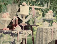Modern Vintage Baby Shower: Love the tea cups and bows, almost like Alice in Wonderland.