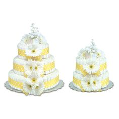Want something a little different for baby shower centerpieces? Use gerber daisy diaper cakes as centerpieces that double as gifts!