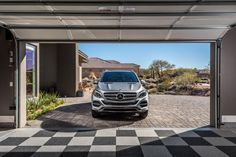 A smart garage door, custom storage system, smart bike lift and carpet floor tiles are included in this attractive three car garage that combines style, storage, and the user-friendly benefits of technology.