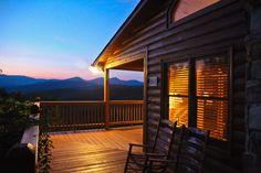 Nightfall at luxurious cabin, tasteful decor, sunset views, gas log fireplace, wi fi, pool table, hot tub, 3 bedroom 3 baths, paved access, located near Blue Ridge GA @ www.mtngetawaycabins.com
