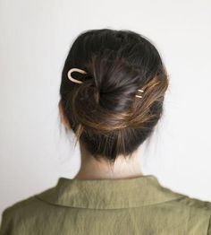 Fasten up a twirled 'do with this handcrafted hair pin. Fashioned in the style of an extra-large bobby pin, the bend of the pin is embellished with a vegetable tanned leather wrap.
