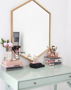 17 gorgeous makeup storage ideas | beauty | vanity organization ideas | Reuse candle holders + cups and stick them neatly on books
