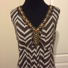 Chico's brown/cream Maxi Dress with beading size 2 Like New! Only wore a couple times! Chico's long maxi dress, v neck with beading at the neckline. Fits size 12/14, because of the cut may fit 16 too. Cute with brown cardigan too! Chico's Dresses Maxi