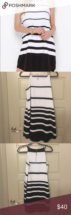 """BB Dakota black &a white shift dress Shift your gaze to better days, relaxing in style in the BB Dakota  Black and White Striped Shift Dress! This lovely woven poly shift has a horizontal striped pattern, a rounded neckline, and a sleeveless design. Back keyhole has top button closure. Fully lined. Dress measures 2"""" longer at back. 100% Polyester BB Dakota Dresses"""