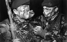 A Royal Marine of 3 Commando Brigade helps another to apply camouflage face paint in preparation for the San Carlos landings on May 1982 Falklands War. Camouflage Face Paint, Marine Commandos, Georgia, Parachute Regiment, Lance Corporal, British Armed Forces, Falklands War, Green Beret, Royal Marines