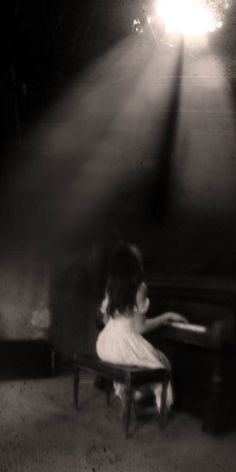 girl at piano with light