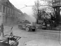 US 9th Armored Division halftracks advance through Engers, Germany, March 27, 1945