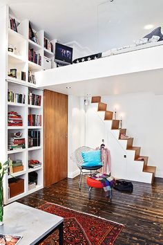 Arrangement of bed over the door and stairs on the side with storage make a nice arrangement. I think I would have bed rails some way...