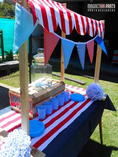 Its so fun to have the red/white theme and colorful flag pennants on the drink table too!