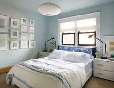 Light & Airy Bedroom | Placing the bed underneath the window gives this room a soothing natural focal point. The ikat headboard fabric in shades of blue adds interest without being overpowering. Brass hardware and modern reading lamps add edge, while the pendant light floats cloud-like over the airy space. | #findyourbalance #tetley #bedroom #interiordesign