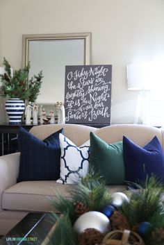 Navy and Green Christmas Living Room Decor. LOVE the 'O Holy Night' canvas art - Life On Virginia Street decor blue living room Holiday Home Tour Details with Home Decorators + A Giveaway! Blue Christmas Decor, Christmas Living Rooms, Christmas Mantels, Modern Christmas, Christmas Home, Christmas Decorations, Christmas Villages, Vintage Christmas, Silver Christmas