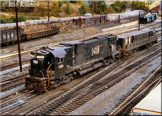Norfolk & Western C630 #1131 appears to be relegated to switching duties during its final years of service as it travels through the large terminal in Bluefield, West Virginia with slug #9910 during October of 1980.