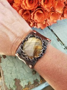 Check out this item in my Etsy shop https://www.etsy.com/listing/548887402/labradorite-cabochon-leather-bracelet
