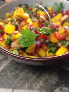 How to Make Mango Salsa...  I just made this and used mango, jalapeños, cilantro, sweet mini red peppers, juice of one large lime, red onion and a few dashes of cayenne pepper to taste. (skipped the brown sugar all together!) Was the best mango salsa ever!