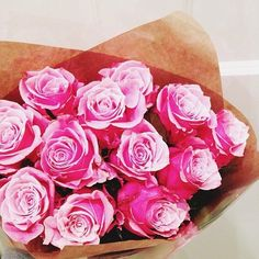 Hot pink flowers, brown paper
