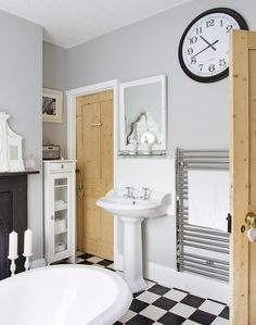 A slimline storage unit works well in this compact bathroom. A chequerboard floor creates drama and adds character