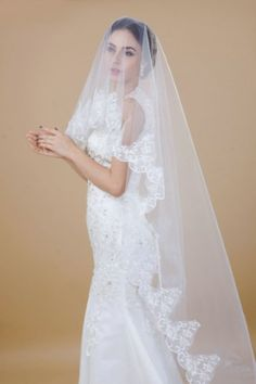 Not prime but can return $30 BUY THIS!  Luxury One-tier White/Ivory Cathedral Lace Paillette Wedding Veil With No Comb For Bridal Gown (White) nero0617 http://www.amazon.com/dp/B00G555Q94/ref=cm_sw_r_pi_dp_VkpRtb1ZYNP7NWRT
