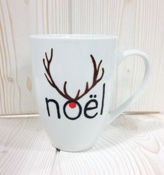 Christmas mug. Start by writing the word Christmas with a procelain painter noi …. Diy Christmas Mugs, Christmas Wine Glasses, Handmade Christmas, Christmas Time, Mug Noel, Tassen Design, Natal Diy, Mug Decorating, Sharpie Crafts