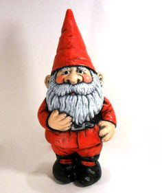 Ceramic hand painted Christmas garden gnome, medium sized (14 inches). Hand-painted Santa Claus gnome is a perfect decoration for gnome lovers for Christmas! Weatherproof makes this gnome great for either indoor or outdoor decor. Can simply be cleaned with a cloth and water (or diluted cleaner). **Dimensions: 14 inches tall   **This item is hand made from start to finish in my shop. We pour the mold, sand the item of any imperfections, fire in one of our studios kilns. Finally I paint the…