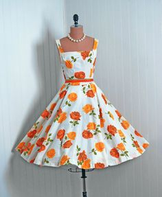 I think this is beautiful. Love the white background with the bright orange roses. - 1950's Vintage Orange-Yellow Roses Floral-Garden Print Cotton-