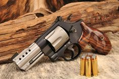S&W Model 329 Full Custom with V8 Hybra-Port, moon-clipped, BCA rear, WC interchangeable front sight, World Class Cocobolo grips