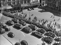Scene showing trucks piled with wreaths in Cathedral Square, Christchurch, during the civic outdoor funeral service for victims of the Ballantyne'. South Pacific, Pacific Ocean, Nz History, Christchurch New Zealand, City Library, State Of Arizona, Department Store, Funeral, Cathedral